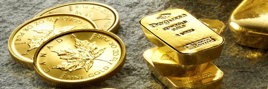 Goldbarren mit Goldmuenzen